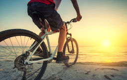 Ride on bike on the beach Royalty Free Stock Image