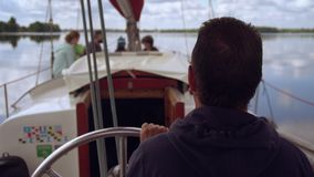 Ride on a boat in summer. Captain steers vessel with tourists. everyone enjoys warm weather stock footage