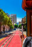 Ride with the cable car in San Francisco. The picture shows a person riding on the famous MUNI train on Powell-Mason line down the hill of Powell Street in San stock photography
