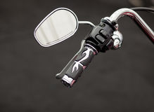 Ride carefully!. Motorcycle rear view mirror with design handlebar and controls Royalty Free Stock Image