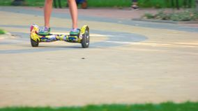 Ride on colourful gyroscooter in a park. Driving gyroboard close up stock footage