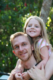 Ride on Daddys Shoulders. Little Girl on Daddy's Shoulders Royalty Free Stock Photo