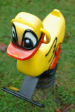Ride-a-duck. Child's ride stock images
