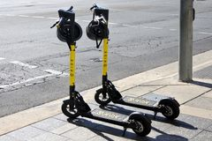 Ride E-scooters in Adelaide city South Australia. Two Ride E-scooters in Adelaide city, South Australia. To ride an e-scooter in Adelaide, you will need to be at stock images