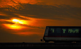 A Ride in the Evening. A beautiful sunset sets the stage for a wonderful ride home in the mass transit royalty free stock photos