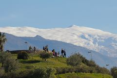 Green mount of Granada with a view of Sierra Nevada royalty free stock photography