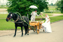 Ride and groom in carriage. Romantic Bride and groom in carriage with horse on wedding day Royalty Free Stock Photography