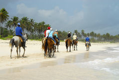 Ride on horseback on the beach. People were on horseback by the beautiful Macao beach in Punta Cana, Dominican Republic royalty free stock photo