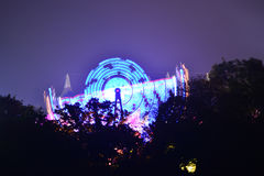 Ride at the Isle of Wight Festival. Fairground rides create silhouettes with trees at the Isle of Wight Festival in Newport, Isle of Wight, Uk Stock Photos