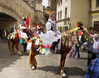 Men in traditional costume on horses parade Royalty Free Stock Photography