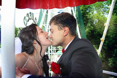 Ride kiss her groom`s nose Stock Images