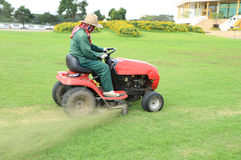 Ride-on lawn mower cutting grass Stock Images