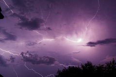 Ride the lightning. Series of lightnings in the night sky stock photos