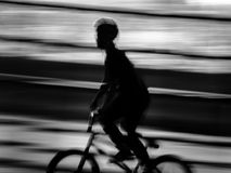 Ride in motion blur. Man ride bmx in motion blur abstract background Royalty Free Stock Images