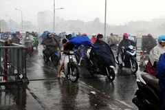 Ride motorbike in heavy rain, high wind Royalty Free Stock Images