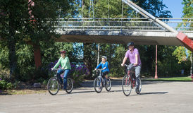 Ride in the Park.psd. A young family ride along the bike path at Alton Baker Park by the DeFazio bike bridge in Eugene Oregon Stock Photos