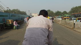 Ride on a rickshaw in crowded traffic stock video