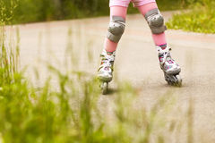 Ride on roller skates Royalty Free Stock Image