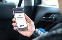 Ride share customer and passenger sitting in the backseat of a car. stock photos