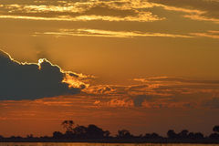 Ride into the sunset. Sunset over Chobe River in Botswana Royalty Free Stock Photo