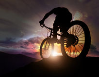 Ride to the future. Bicycle man watching the sunset Royalty Free Stock Images