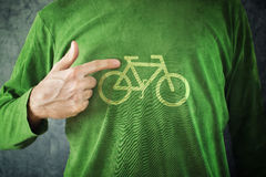 Ride your bike. Man pointing to bicycle insignia printed on his Royalty Free Stock Photo