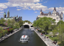 Rideau Canal, The Parliament of Canada, Ottawa. Rideau Canal, The Parliament of Canada and boat, Ottawa Stock Photo