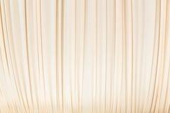 Rideau en tissu dans la couleur jaune en pastel Photographie stock