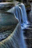 The Rideau Falls pours into the Ottawa River in Canada Stock Photo