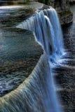 The Rideau Falls pours into the Ottawa River in Canada Stock Photo