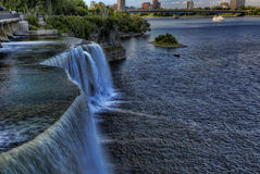 The Rideau Falls pours into the Ottawa River Stock Photo