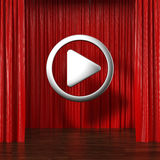 Rideaux rouges avec le bouton de jeu Images libres de droits