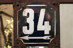 Riden ut emaljerad platta nummer 34 Royaltyfri Bild