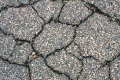 Riden ut och Cracked asfalt royaltyfri foto