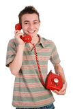 Ridendo sul telefono Immagini Stock