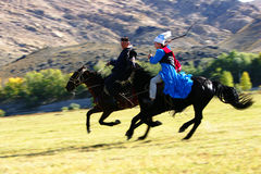 Rider. Two  kazakh rider chasing each other.Xinagjiang province,China.Used for news and articles about the local tribe in Xingjiang Royalty Free Stock Photo