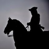 Rider. Silhouette of the rider on the horse Royalty Free Stock Image