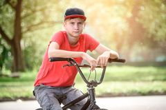 A rider on a bicycle does tricks.  royalty free stock image