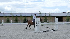 The rider canter on the horse at the arena stock footage