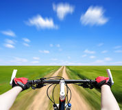 Rider driving bicycle Royalty Free Stock Image