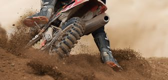 Rider driving in the motocross race. The rear wheel motocross bike royalty free stock photography
