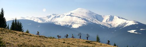 Rider among fantastic snow peaks. Lone rider among fabulous fantastic snow peaks of the Ukrainian Carpathians meets the blossoming spring in skiing on the slopes royalty free stock photo