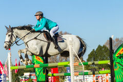 Rider Girl Horse Jumping Photo stock