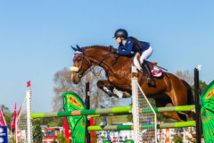 Rider Girl Horse Jumping. Rider girl horse show jumping action closeup equestrian event Royalty Free Stock Photography