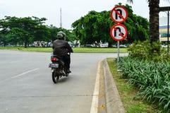 Rider going wrong way Stock Image