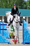 Rider on gray show jump horse Royalty Free Stock Photography