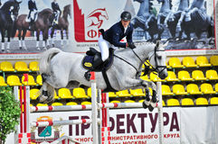 Rider on gray show jump horse Stock Photography