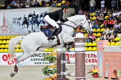 Rider at the grey  jump horse. MOSCOW, RUSSIA - JUNE 26:rider Varna Andis(LAT) at the latvian horse Marmors in stage of the International event CSI4*RR/ Russian Stock Images