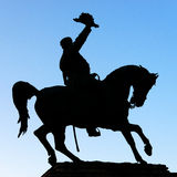 Rider with hat. Knight saluting with hat and riding Stock Photo