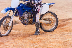 Rider on his motorcycle in the desert Stock Photography